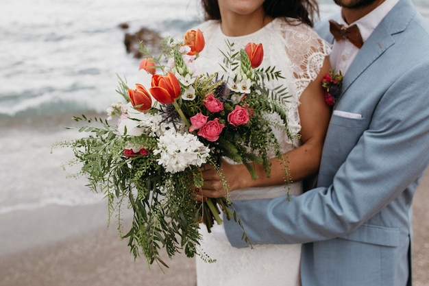 Beautiful couple having a beach wedding