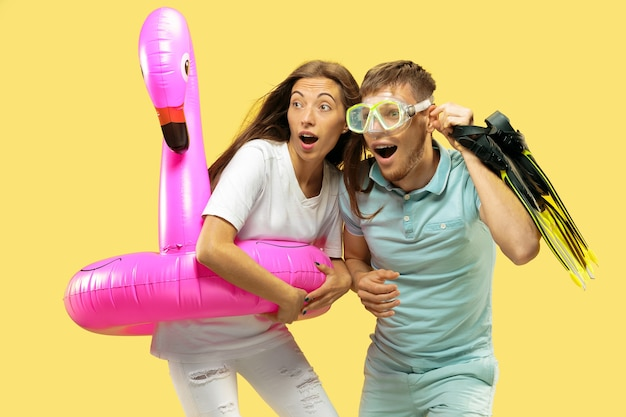 Beautiful couple isolated on yellow studio background