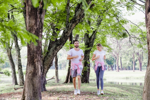 Beautiful couple jogging in park living