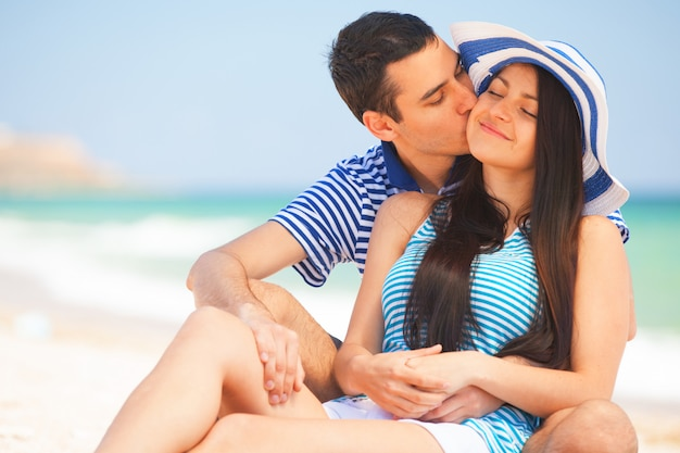 Beautiful couple kissing on the beach.