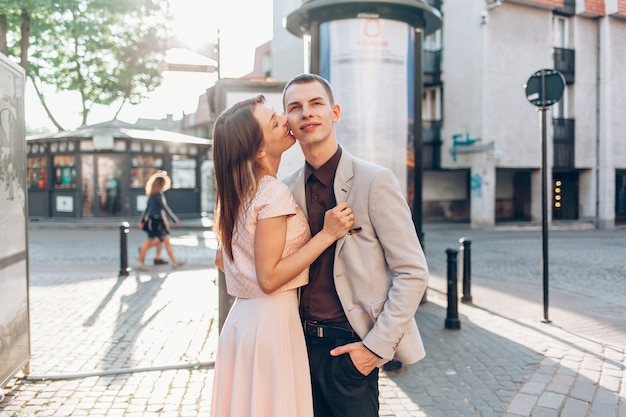 Beautiful couple kissing on the street