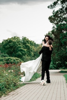 Beautiful couple in love on the blurred background of the city park