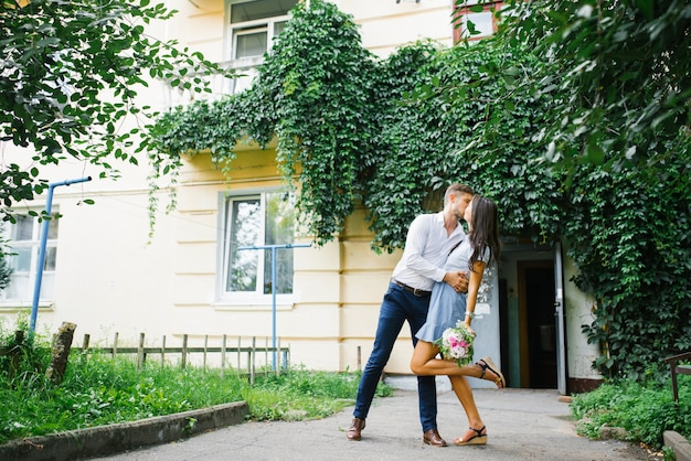Beautiful couple in love guy and girl hug each other in the city in summer.
