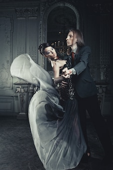 Beautiful couple in love in historical palace