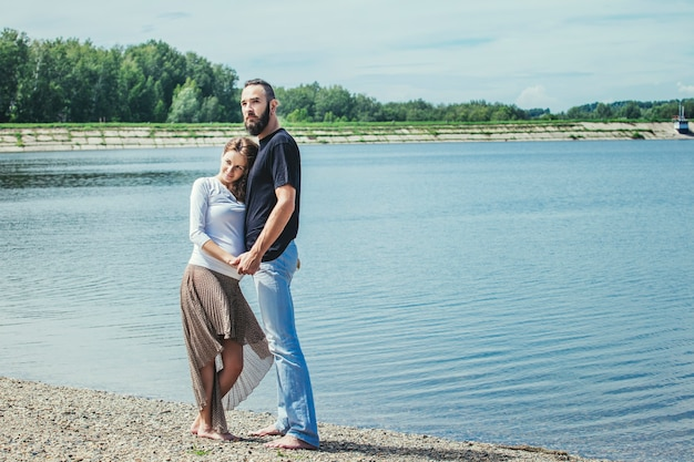 Beautiful couple man and pregnant woman in love on a background