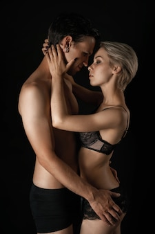 Beautiful couple man and woman in underwear hugging the  of the relationship