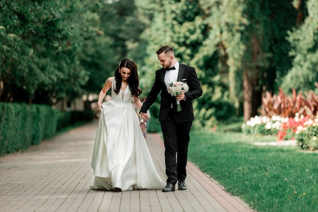 Beautiful couple newlyweds on a walk in the city park