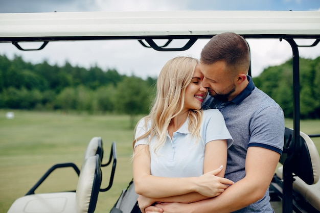 Beautiful couple playing golf on a golf course