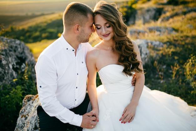 Beautiful couple posing on their wedding day