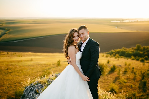 Beautiful couple posing on their wedding day Free Photo
