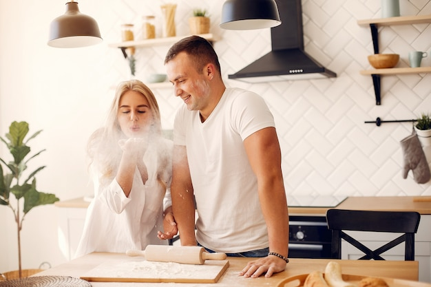 Beautiful couple prepare food in a kitchen