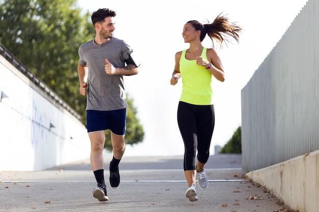 Beautiful couple running in the street.