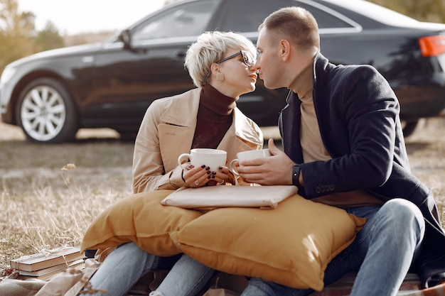 Beautiful couple spend time on a autumn field