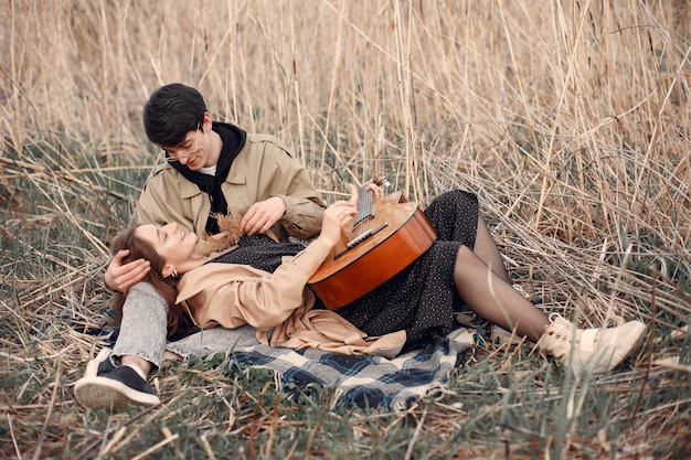 Beautiful couple spend time in an autumn field