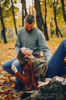Beautiful couple spend time in a autumn park