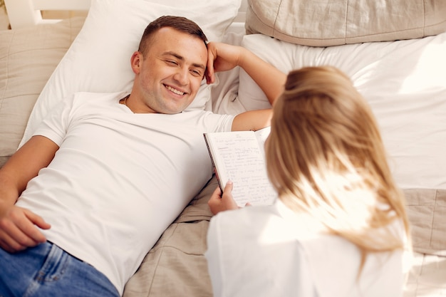 Beautiful couple spend time in the bedroom