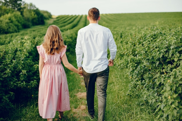 Beautiful couple spend time on a field
