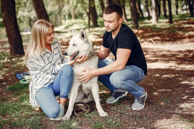 Beautiful couple spend time on a forest