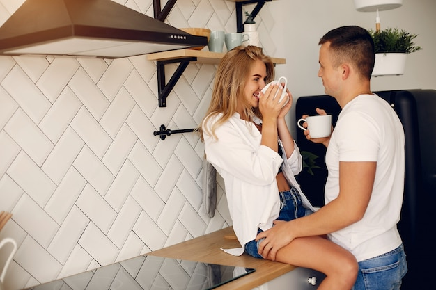 Beautiful couple spend time in a kitchen
