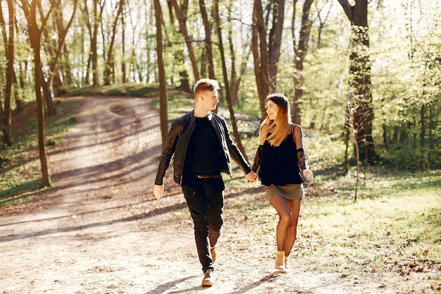 Beautiful couple spend time in a spring park