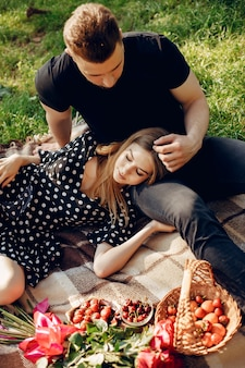 Beautiful couple spend time in a summer field