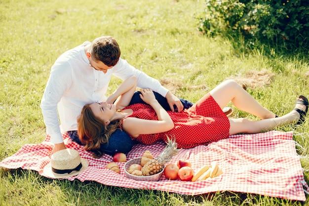 Beautiful couple spend time on a summer field