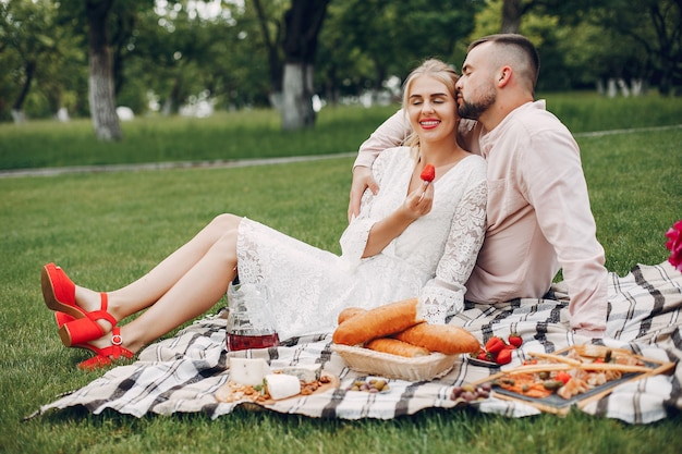 Beautiful couple spend time in a summer garden