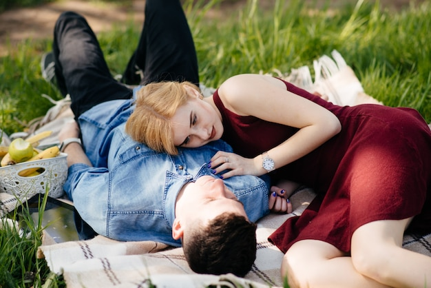 Beautiful couple spend time in a summer park