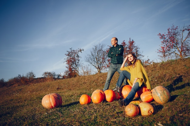 Beautiful couple spends time in an autumn park