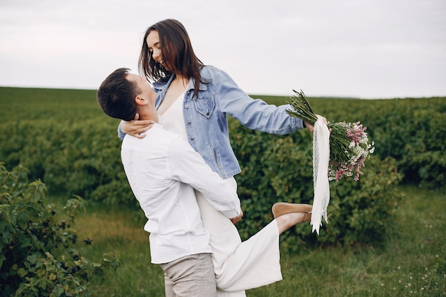 Beautiful couple spends time on a summer field
