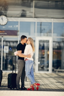 Beautiful couple standing in airport