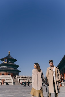 Beautiful couple very much in love exploring china on their honeymoon