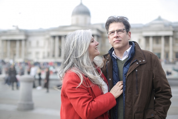 Beautiful couple visiting london, walking in front the national gallery