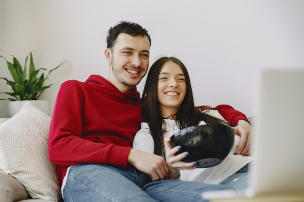 Beautiful couple watching film on the sofa