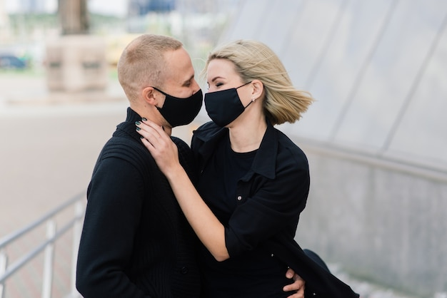 Beautiful couple wearing protective masks