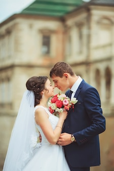 Beautiful couple in wedding dress outdoors near the castle