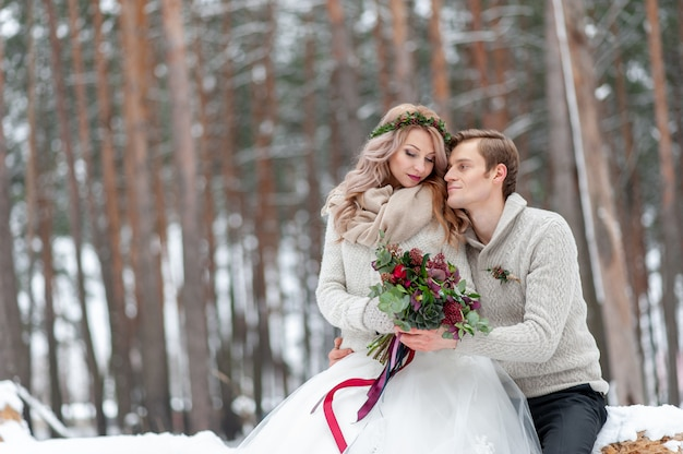 Beautiful couple in winter forest. moment before a kiss. copy space
