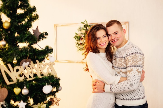 Beautiful couple with christmas decorations