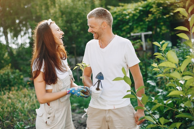 Beautiful couple works in a garden