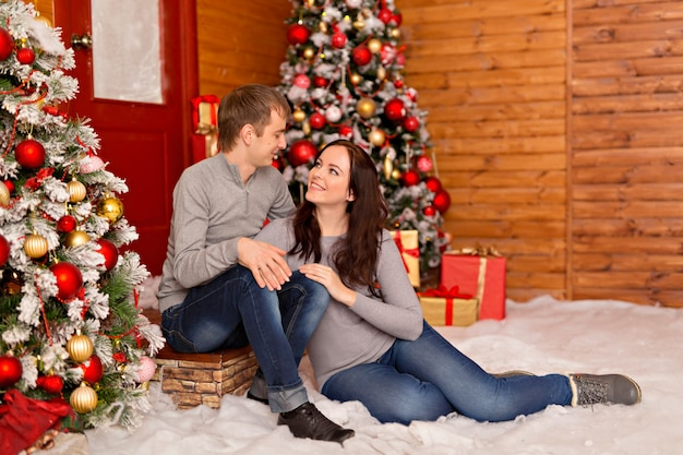 Beautiful couple, young family in anticipation of merry christmas.
