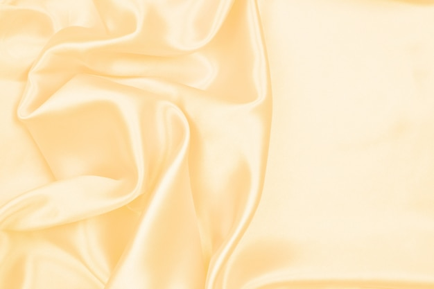Beautiful cream silk texture luxurious satin for abstract background, fabric texture