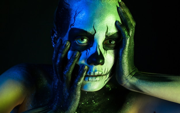 Beautiful creepy girl with skeleton makeup