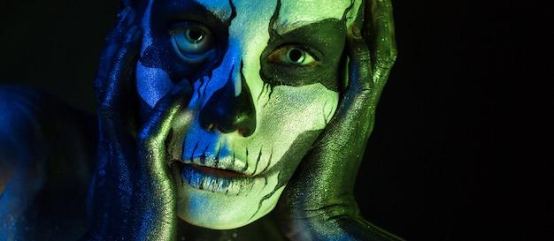 Beautiful creepy girl with skeleton makeup