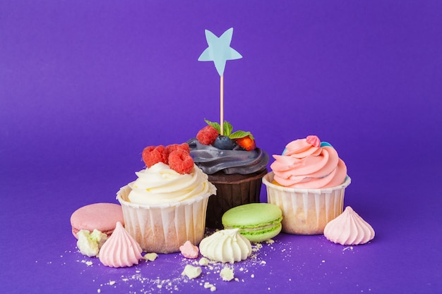 Beautiful cupcake against saturated dark purple background