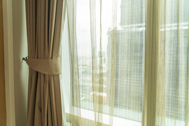 Beautiful curtain with window and sunlight