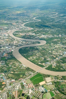 Beautiful curve river was shot on the plane in the noon. it can see farming and valley all around.