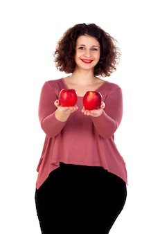 Beautiful curvy girl holding two red apples