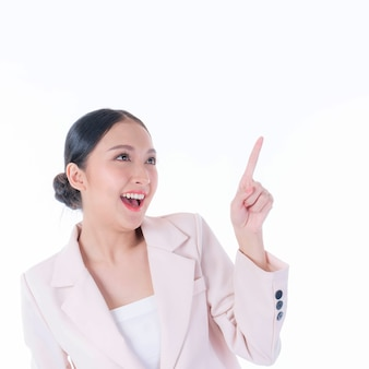 Beautiful cute asian woman smiling and pointing finger to empty copy space , blank space for advertising isolated on white background