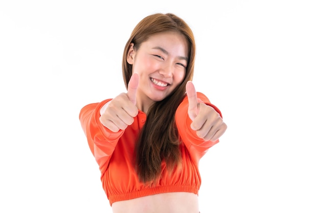 Beautiful cute girl asian woman shows ok sign with hands , smile face enjoy and happy on white background - lifestyle pretty girl concept