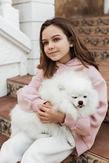 Beautiful cute girl and her companion